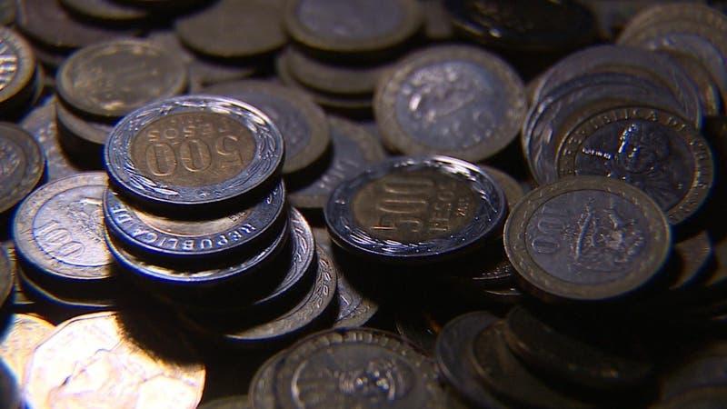 """Llaman """"a romper el chanchito"""" ante escasez de monedas en Chile"""